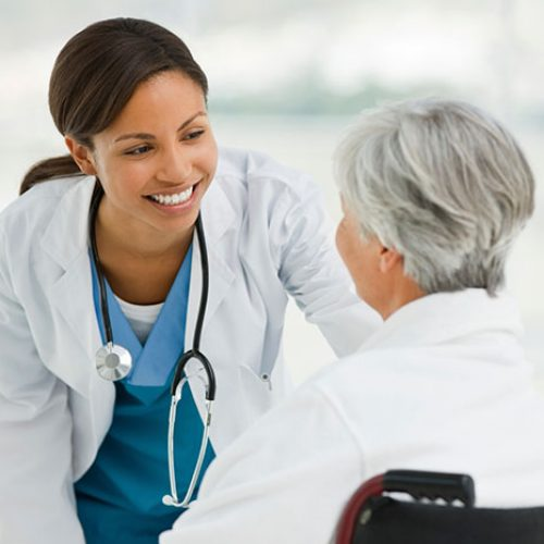 Doctor consulting an old lady
